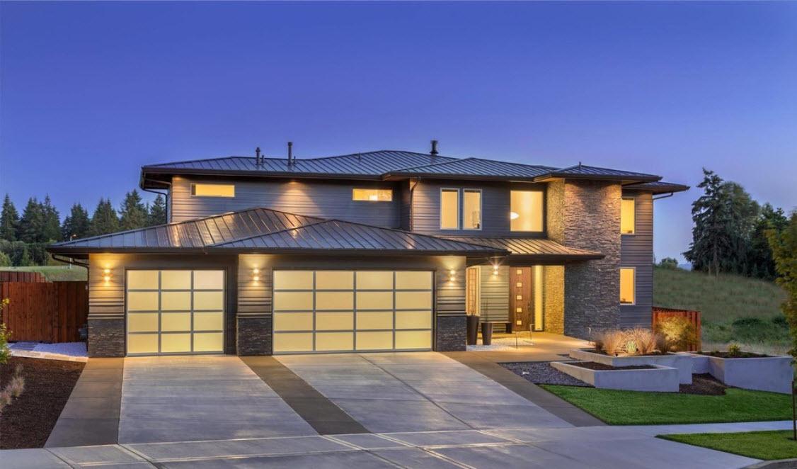 дом с гаражом и ночным освещением