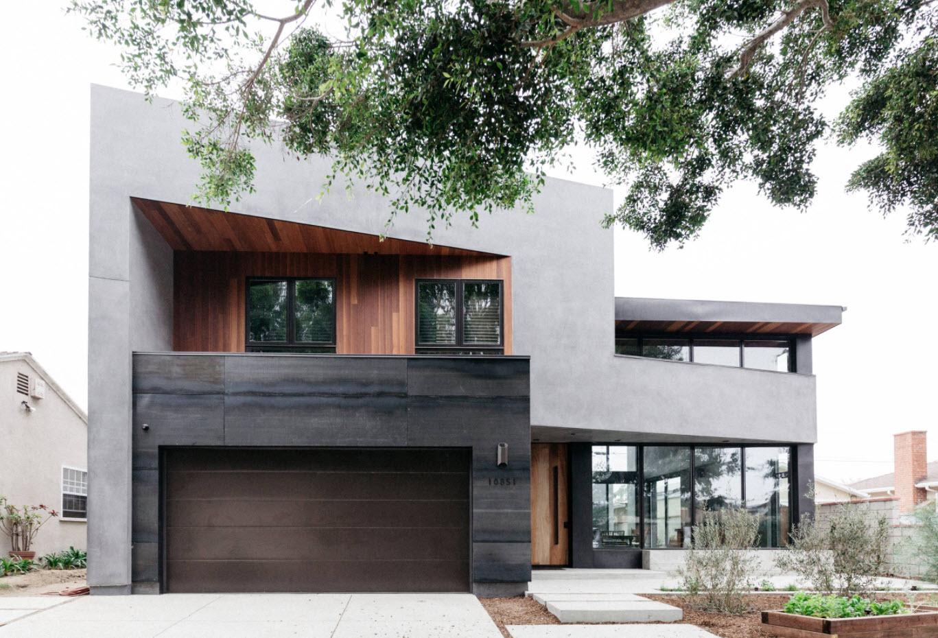 серый дом с большим гаражом и плоской крышей
