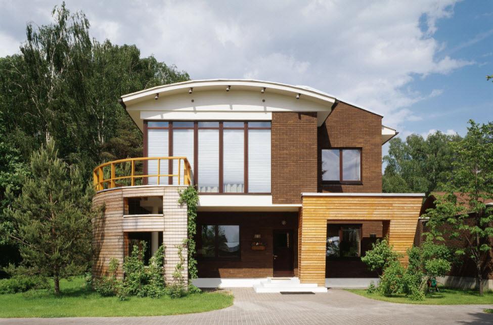 фасад дома необычной планировки