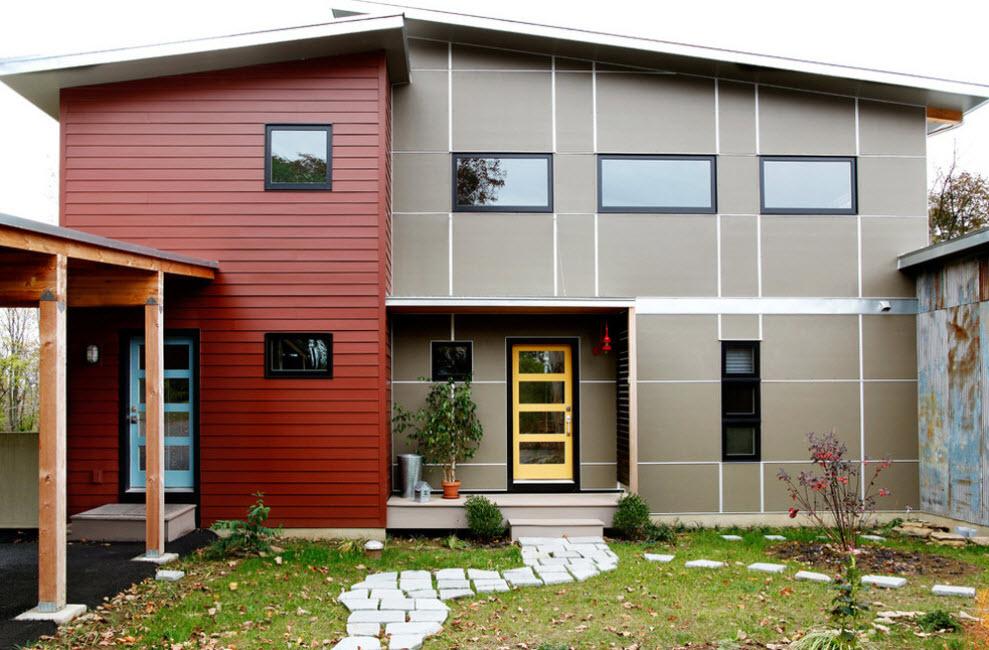 двухцветная отделка дома сайдингом из металла
